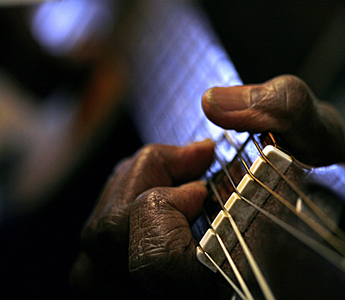 photograph: hands playing guitar